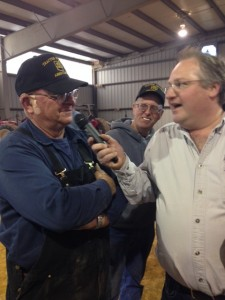 Driver that won on Saturday, being interviewed as the last tractor pulls in his class.