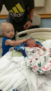 Big brother Chase meeting baby brother Ryker.